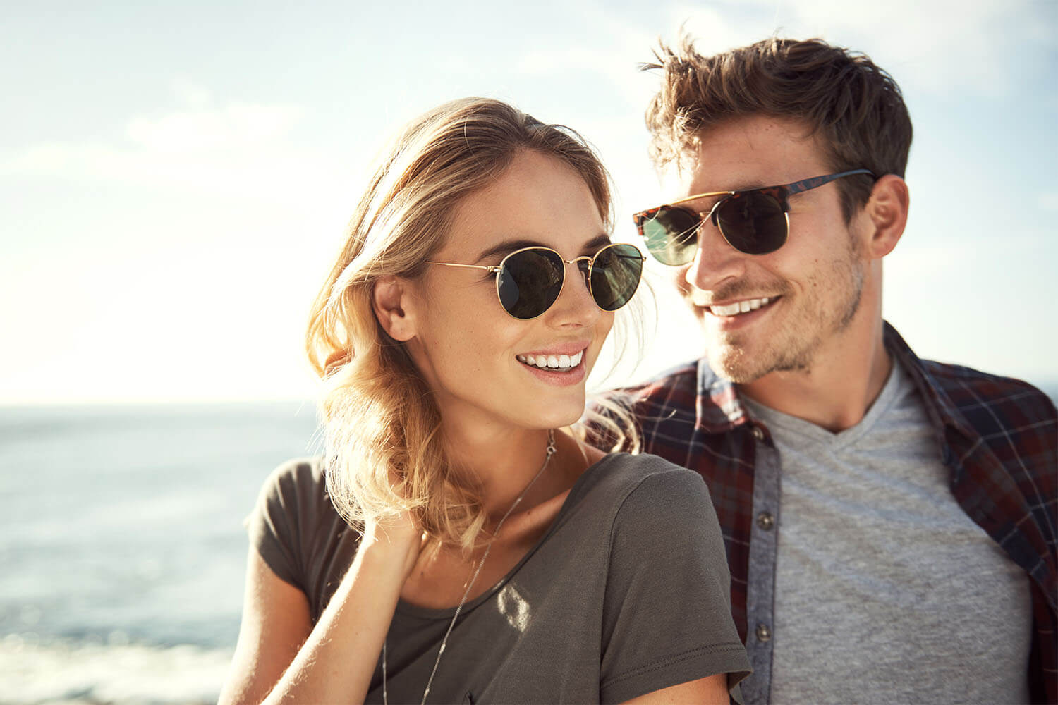 AA smiling couple showing their perfect teeth